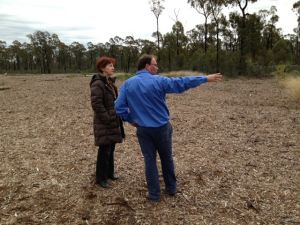 Professor O'Kane inspects Santos rehabilitation site in the Pilliga Forest, near Narrabri.