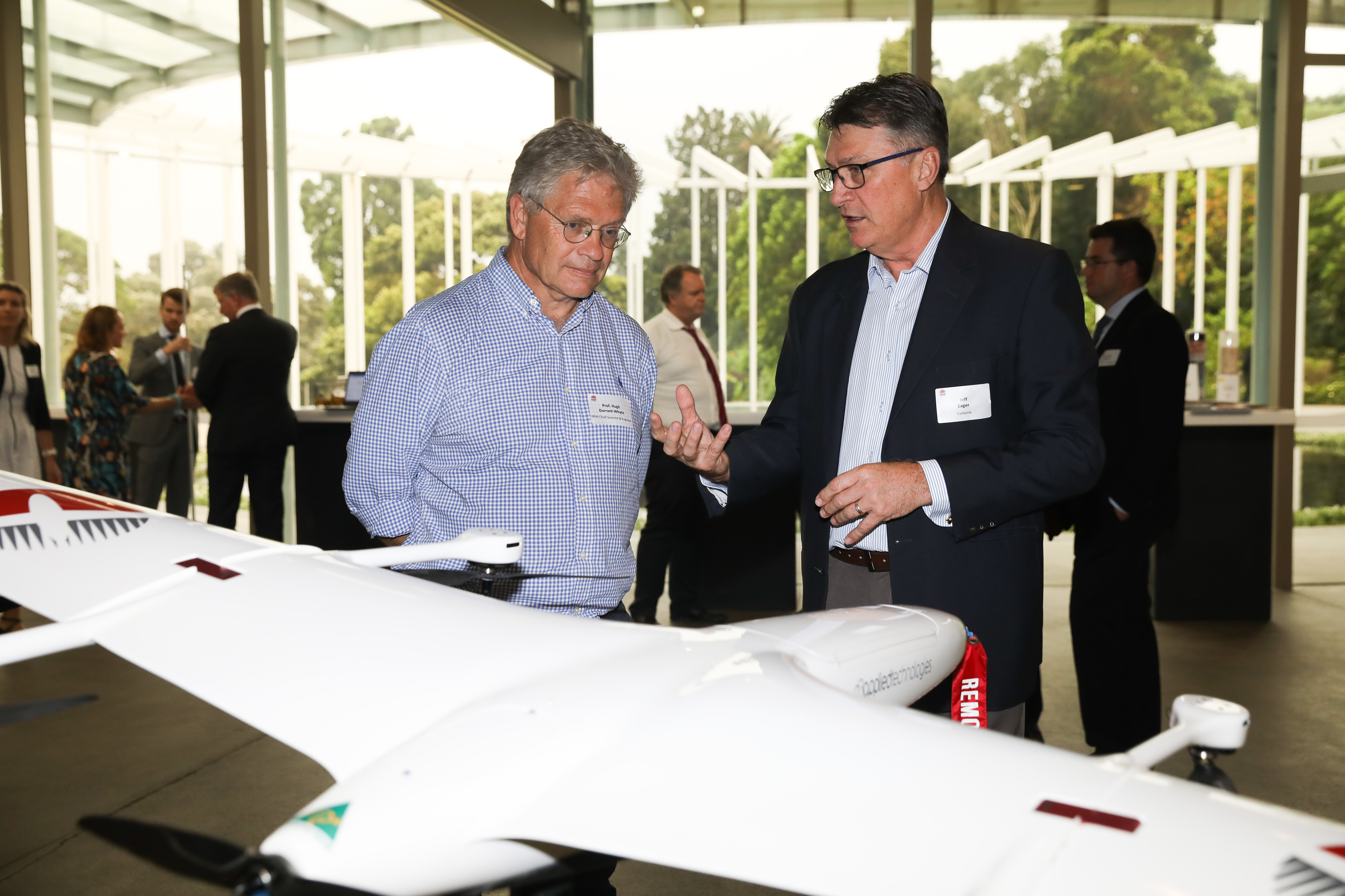 Brad Pickett from Carbonix discussing the Domani drone with Professor Durrant-Whyte